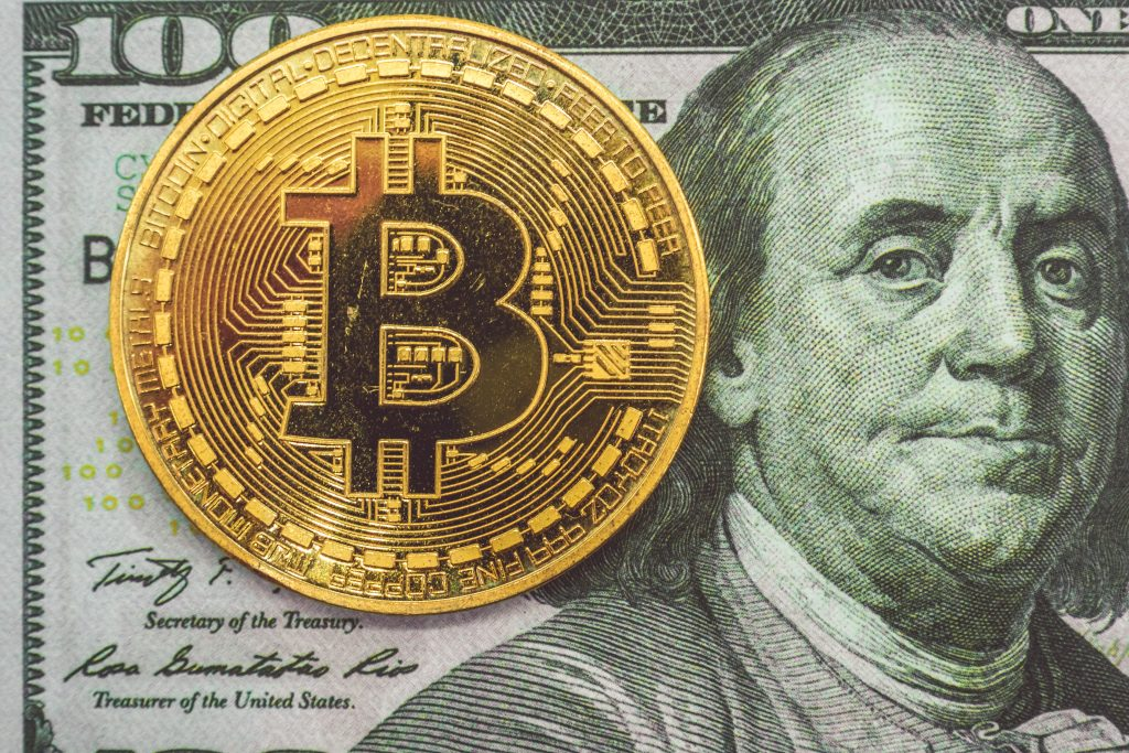 gold and black round bitcoin
